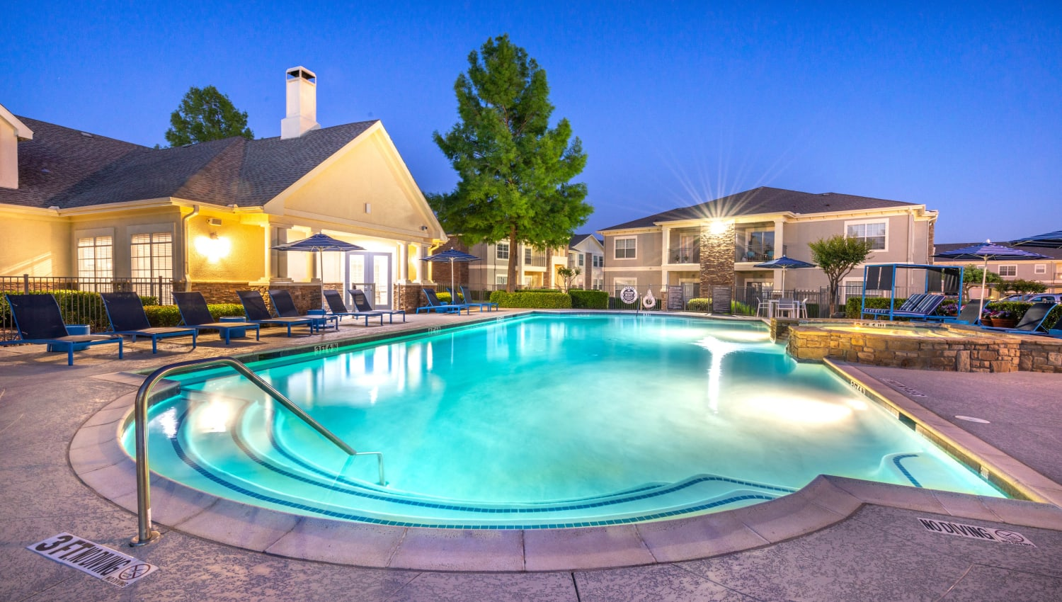 Twilight at the swimming pool area at Olympus Stone Glen in Keller, Texas