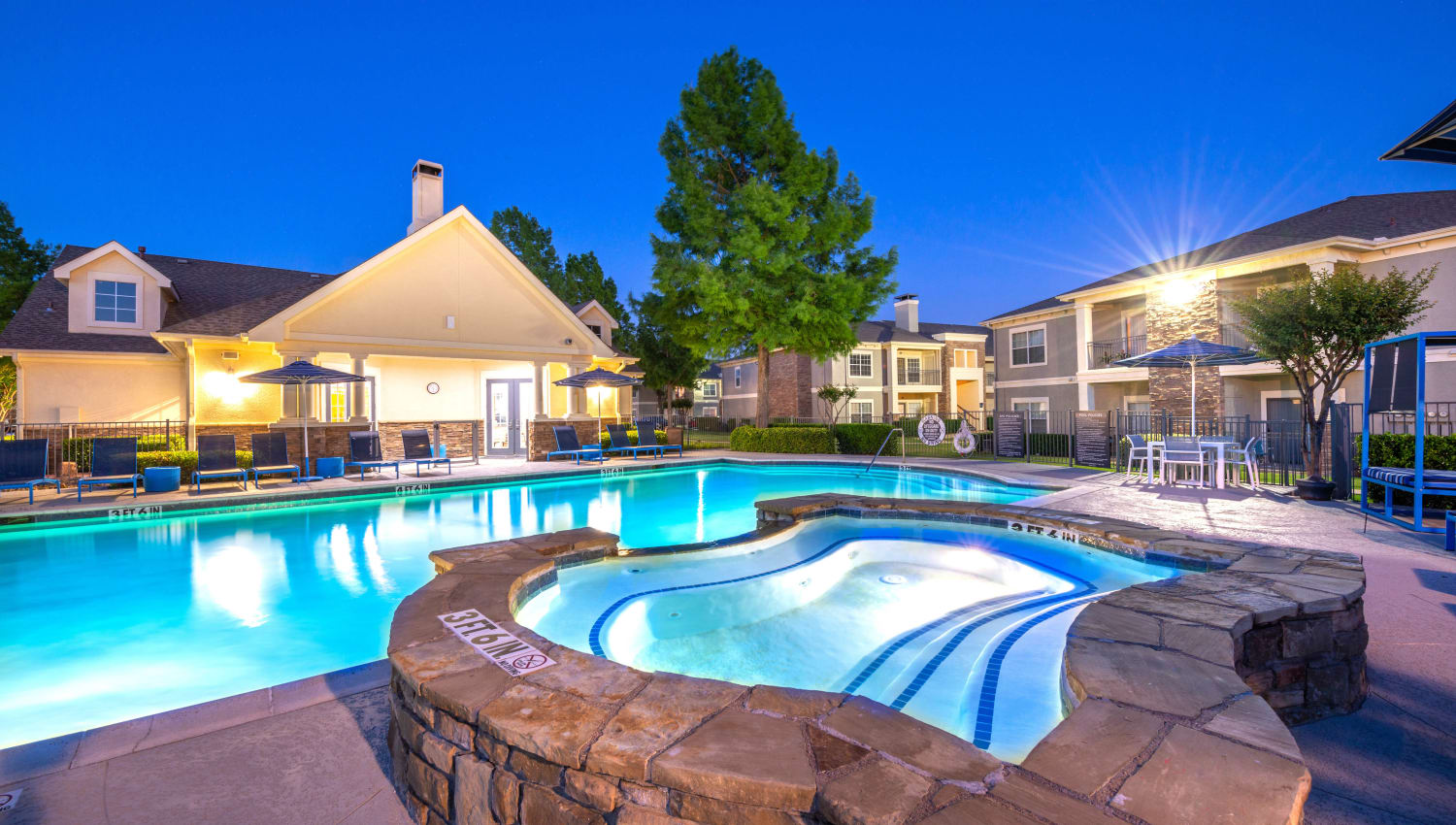 Twilight at the spa looking over the swimming pool at Olympus Stone Glen in Keller, Texas