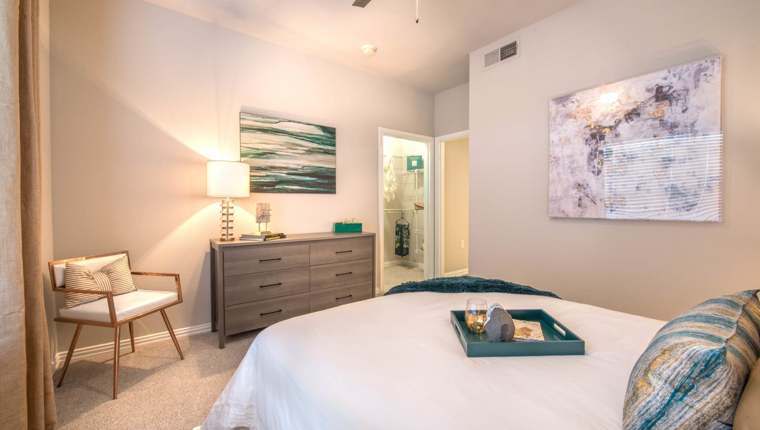 Warm and well-decorated bedroom in a model apartment at Olympus Stone Glen in Keller, Texas