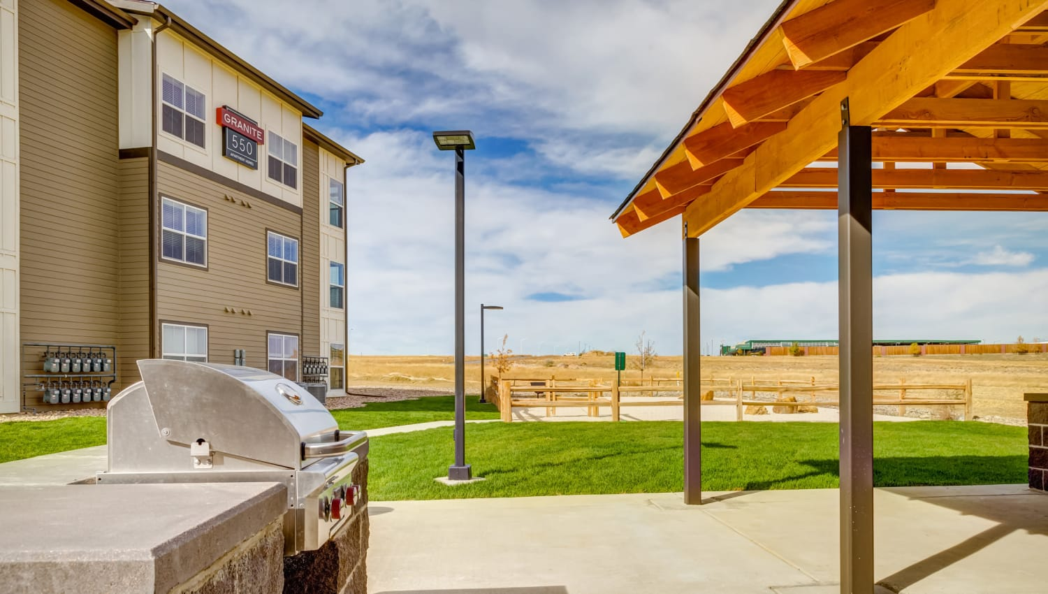 Green grass for you and your pets to play on near the barbecue area at Granite 550 in Casper, Wyoming