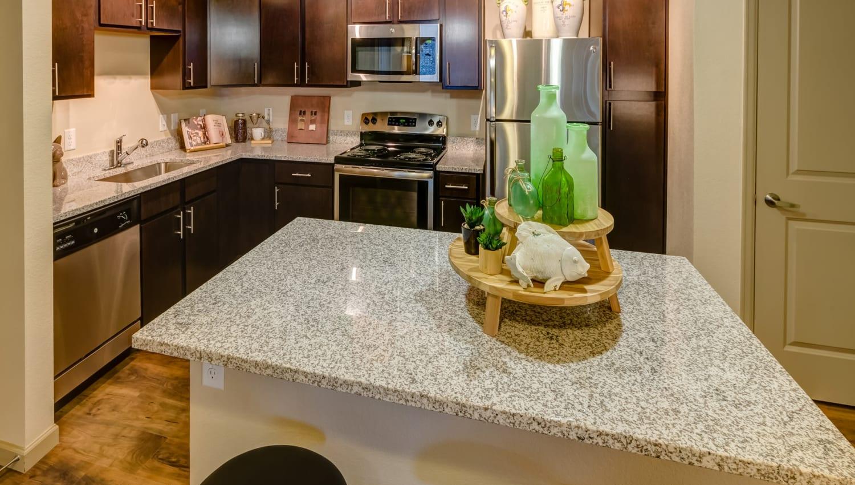 Granite countertops in a model home's kitchen at Granite 550 in Casper, Wyoming