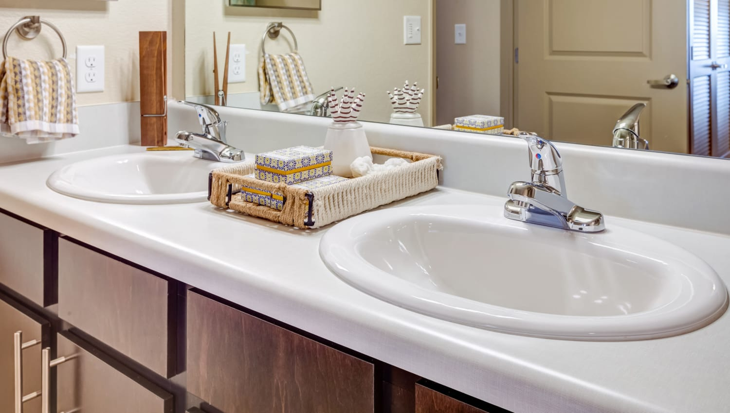 Dual sinks in the master bathroom of a model apartment at Granite 550 in Casper, Wyoming