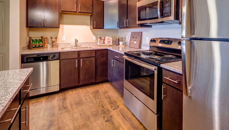 Model home's kitchen with hardwood flooring at Granite 550 in Casper, Wyoming