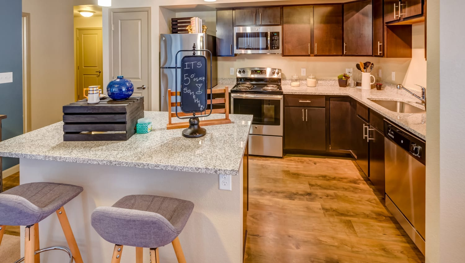 Beautiful wood cabinetry in a model home's kitchen at Granite 550 in Casper, Wyoming