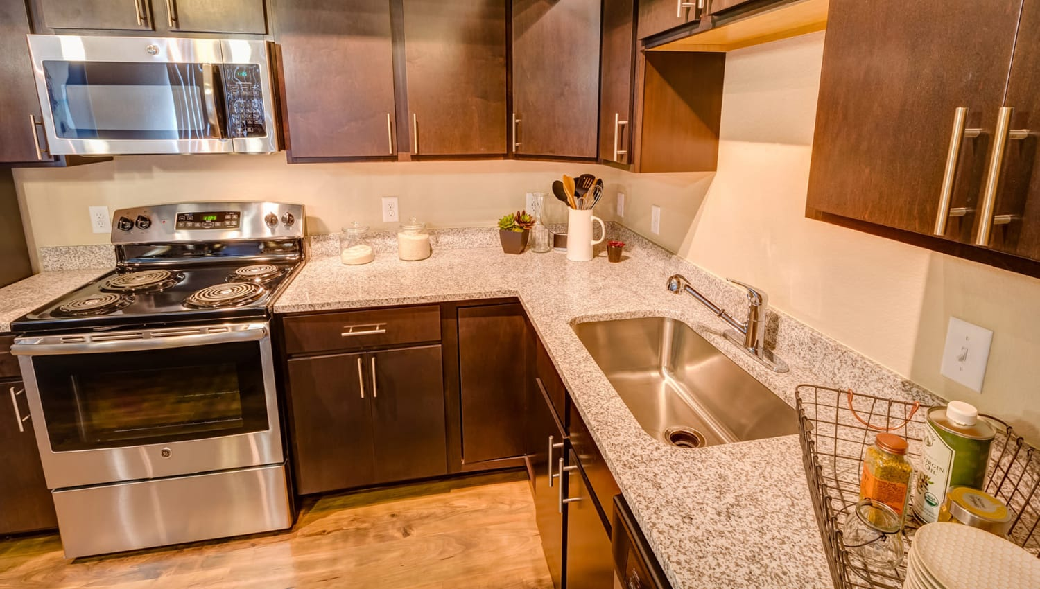 Stainless-steel appliances in a model apartment's kitchen at Granite 550 in Casper, Wyoming