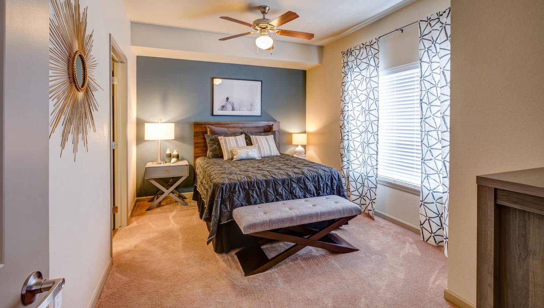 Ceiling fan and plush carpeting in a model home's bedroom at Granite 550 in Casper, Wyoming