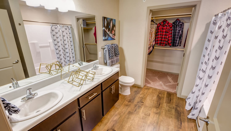 Walk-in closet in the en suite bathroom of model home's master bedroom at Granite 550 in Casper, Wyoming
