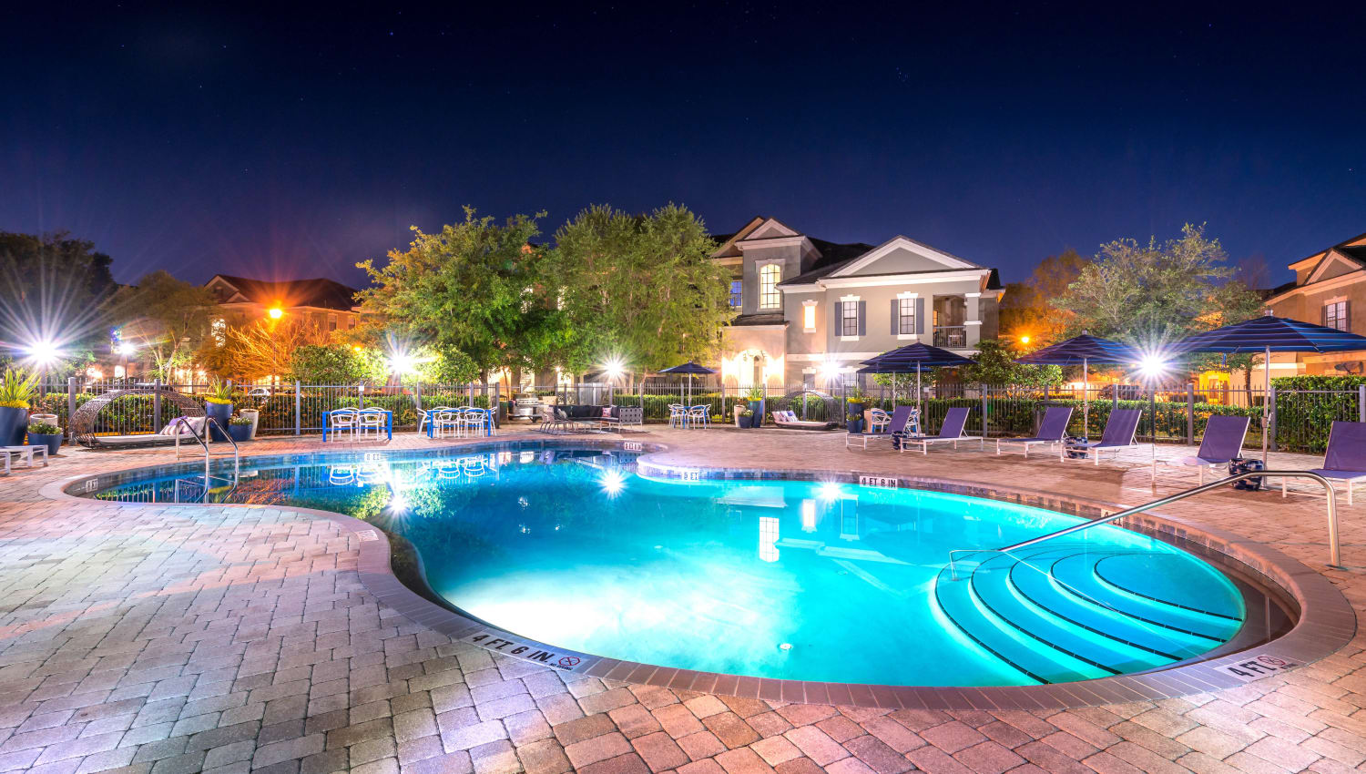 Underwater illumination at the swimming pool in the evening at Mirador & Stovall at River City in Jacksonville, Florida