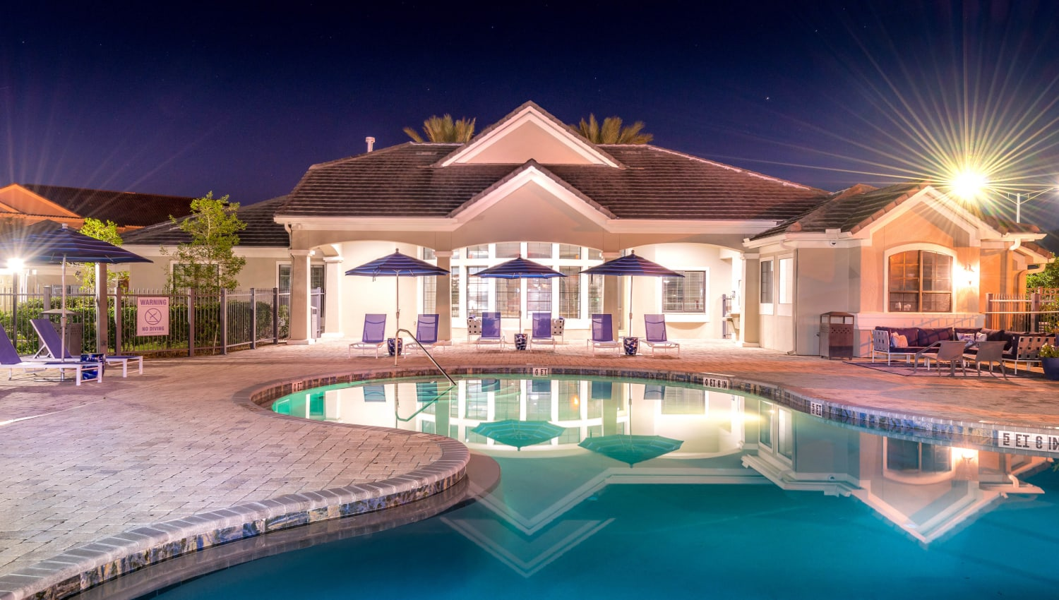 View of the clubhouse from the pool in the evening at Mirador & Stovall at River City in Jacksonville, Florida