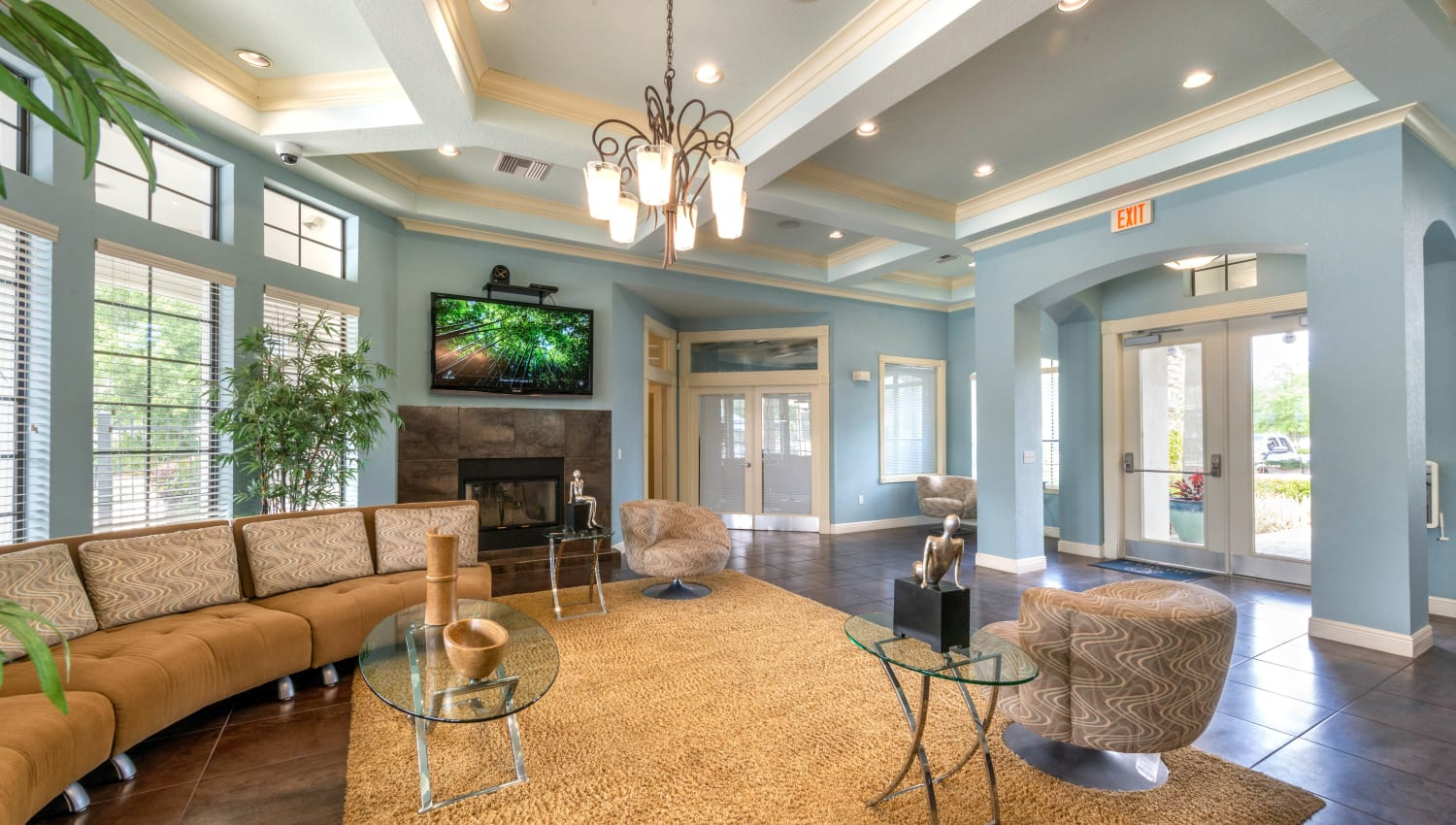 Luxurious clubhouse lounge in front of the fireplace at Mirador & Stovall at River City in Jacksonville, Florida