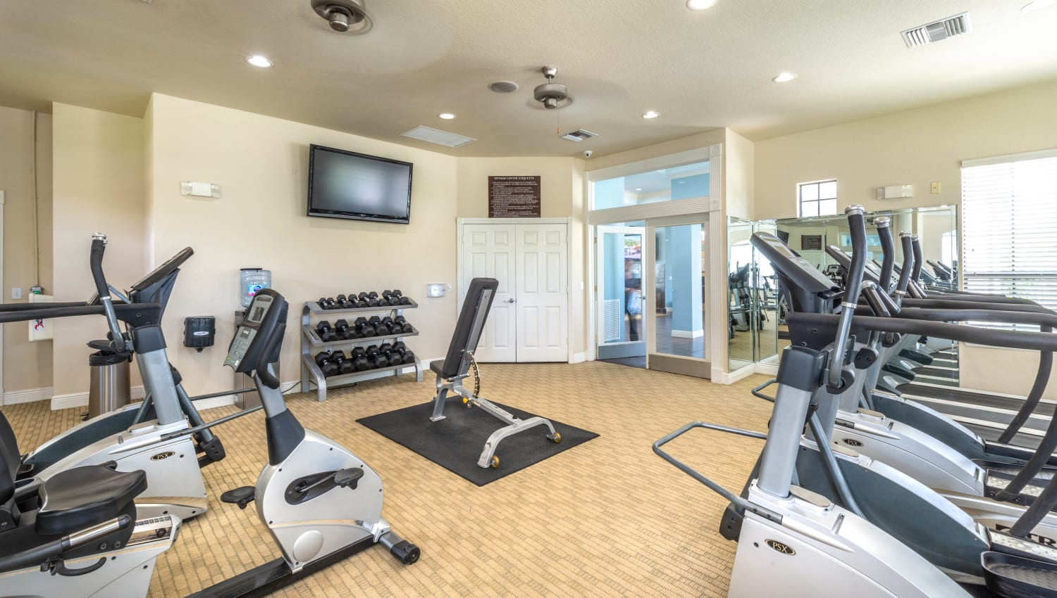 Treadmills and more in the fitness center at Mirador & Stovall at River City in Jacksonville, Florida