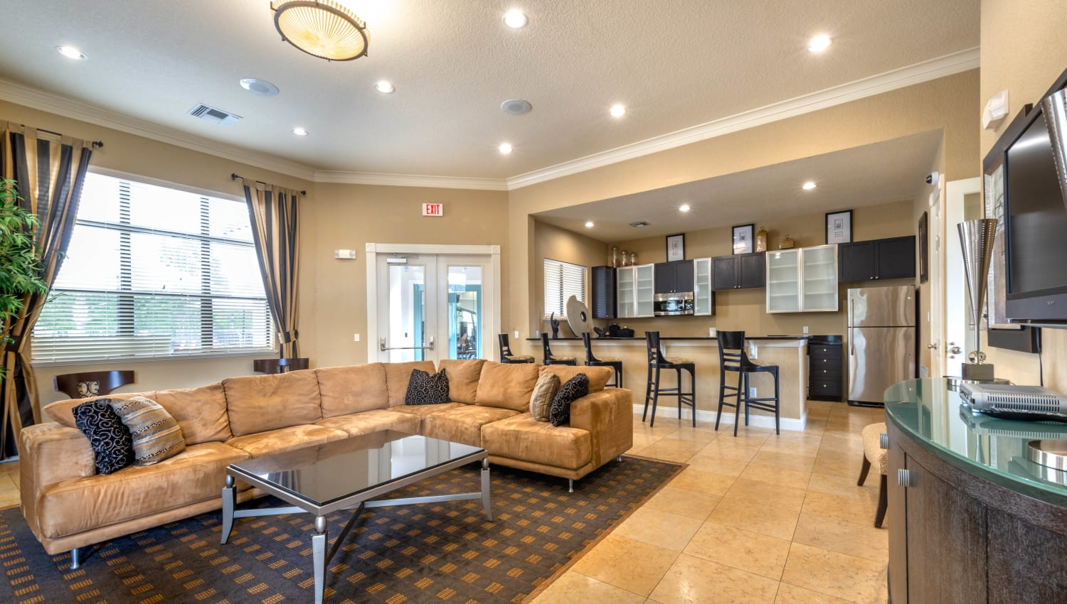 Clubhouse lounge with a nearby demonstration kitchen at Mirador & Stovall at River City in Jacksonville, Florida