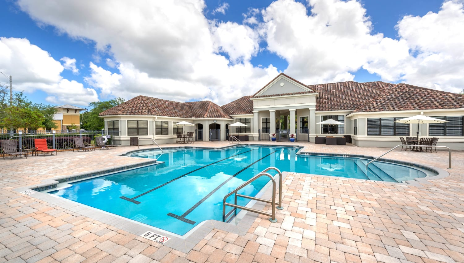 Fluffy clouds above the pool on a beautiful day at Mirador & Stovall at River City in Jacksonville, Florida