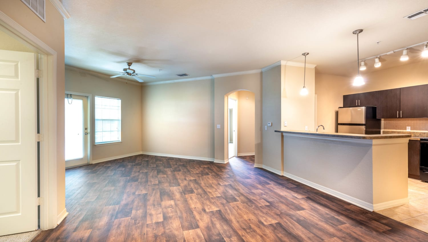 Beautiful hardwood flooring throughout the living areas of a model home at Mirador & Stovall at River City in Jacksonville, Florida