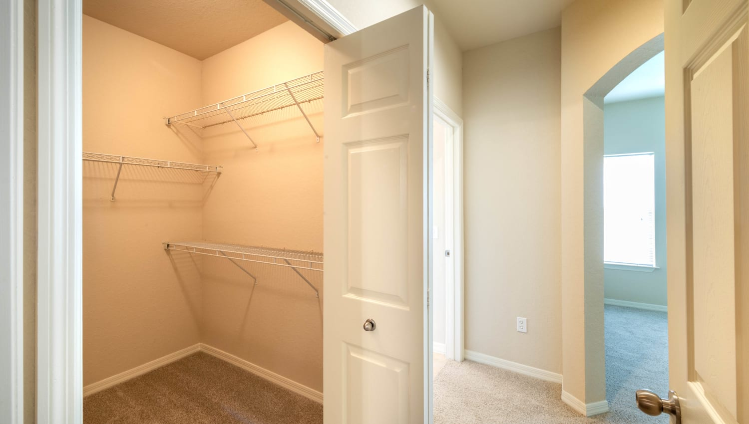 Spacious walk-in closet in a model apartment at Mirador & Stovall at River City in Jacksonville, Florida