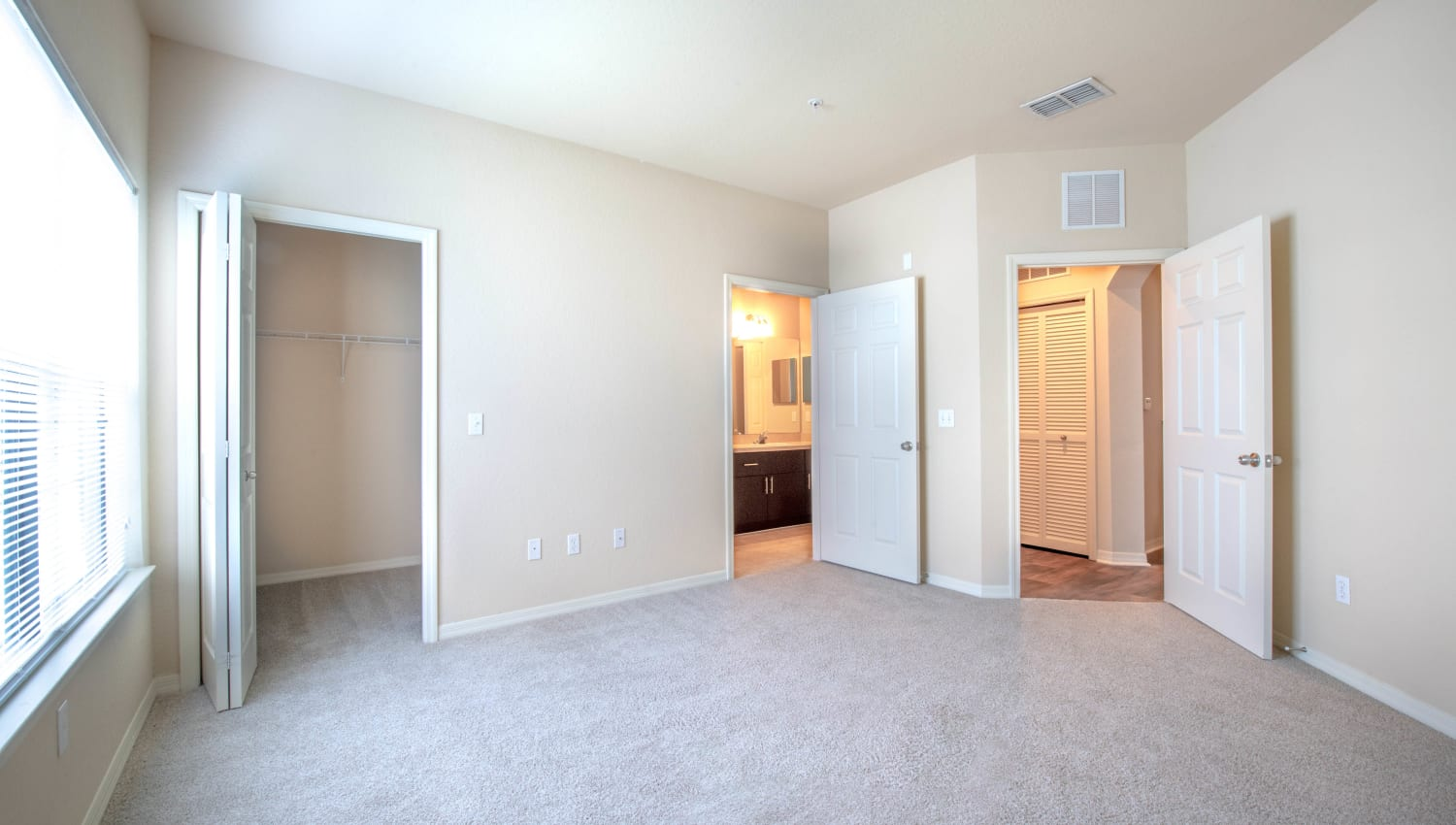Plush carpeting in the bedroom of a model apartment at Mirador & Stovall at River City in Jacksonville, Florida