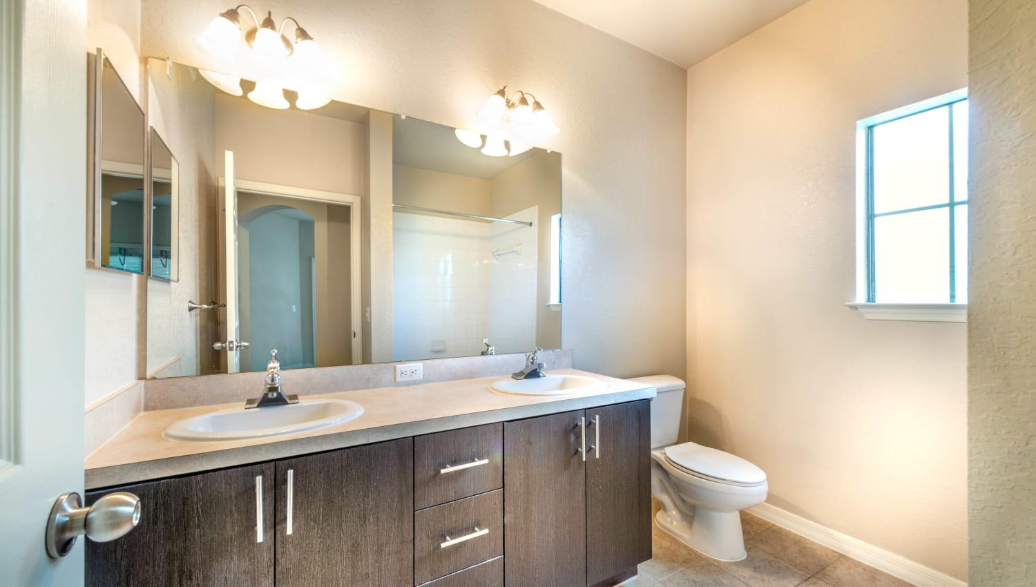 Dual sinks in a model home's master bathroom at Mirador & Stovall at River City in Jacksonville, Florida