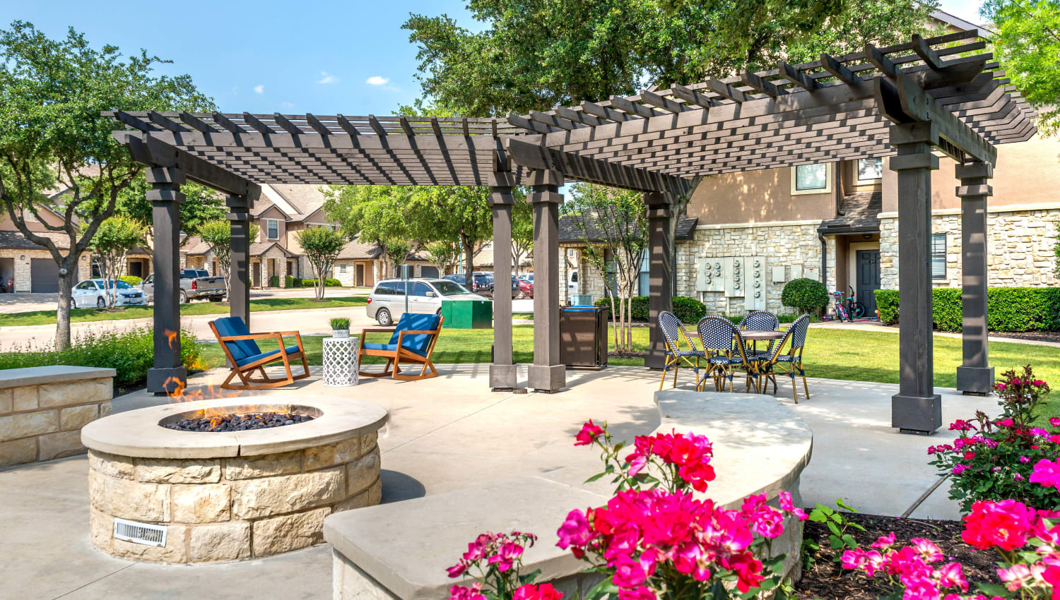 Fire pit and beautiful flora at Olympus Town Center in Keller, Texas