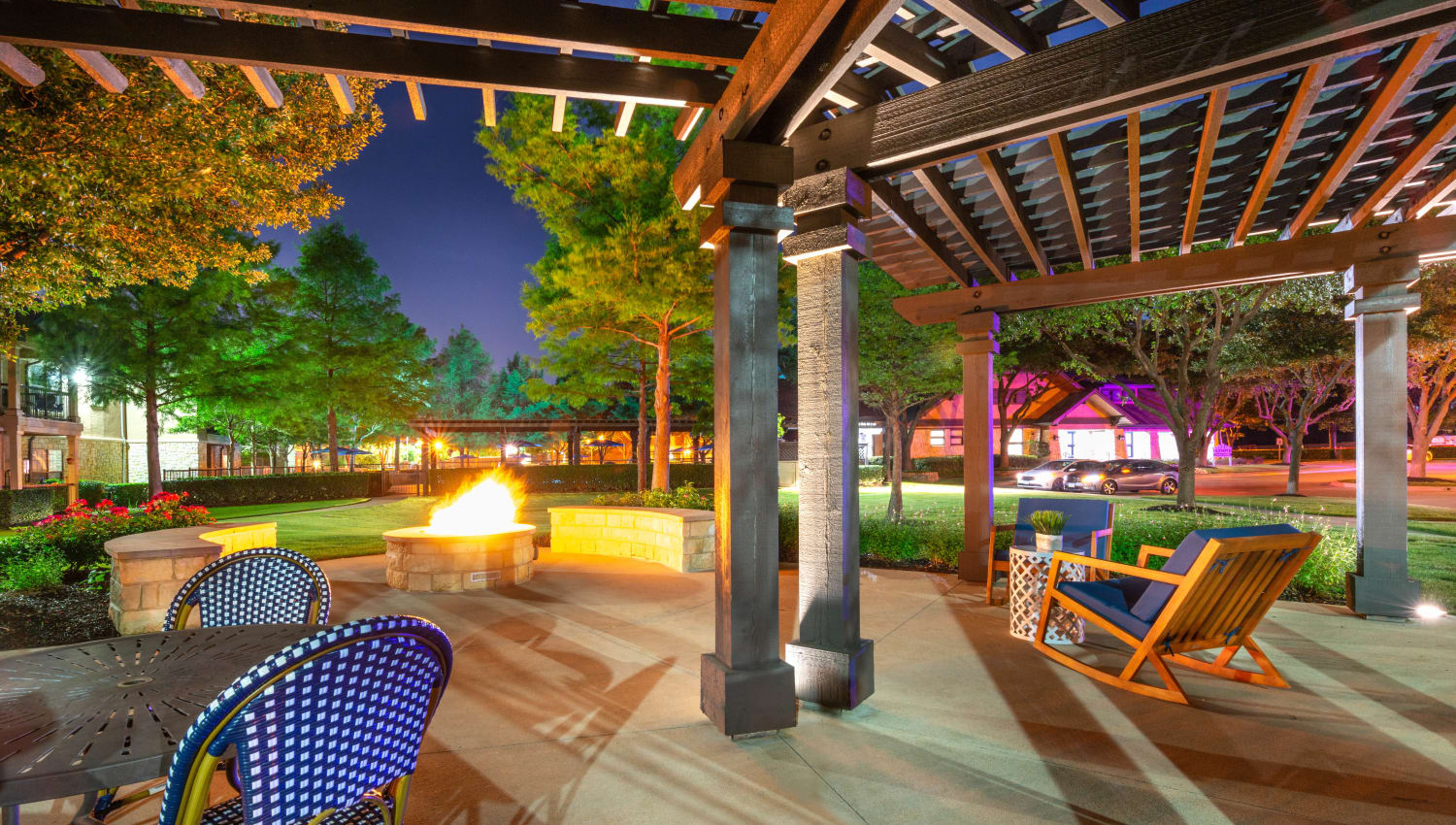 Lounge seating near the fire pit in the evening at Olympus Town Center in Keller, Texas