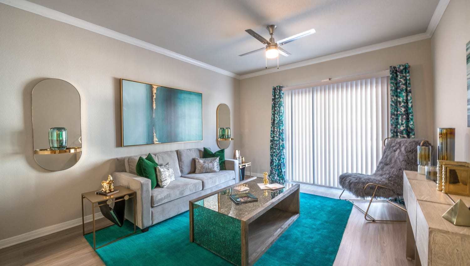 Draped windows and modern decor in a model apartment's living area at Olympus Town Center in Keller, Texas