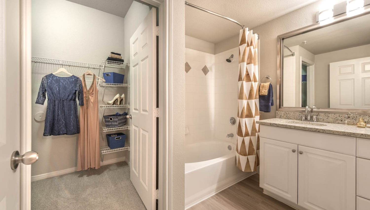 Walk-in closet in the en suite bathroom of a model home's master bedroom at Olympus Town Center in Keller, Texas