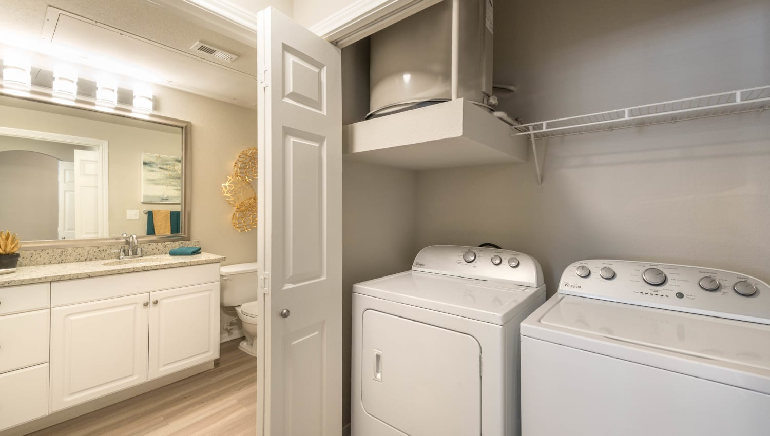 In-unit washer and dryer in a model home at Olympus Town Center in Keller, Texas
