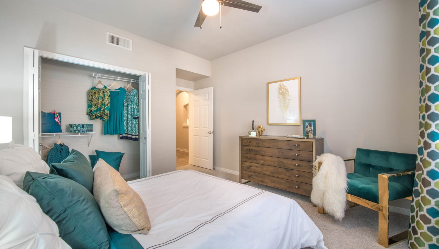 Large closet and a ceiling fan in a model home's bedroom at Olympus Town Center in Keller, Texas