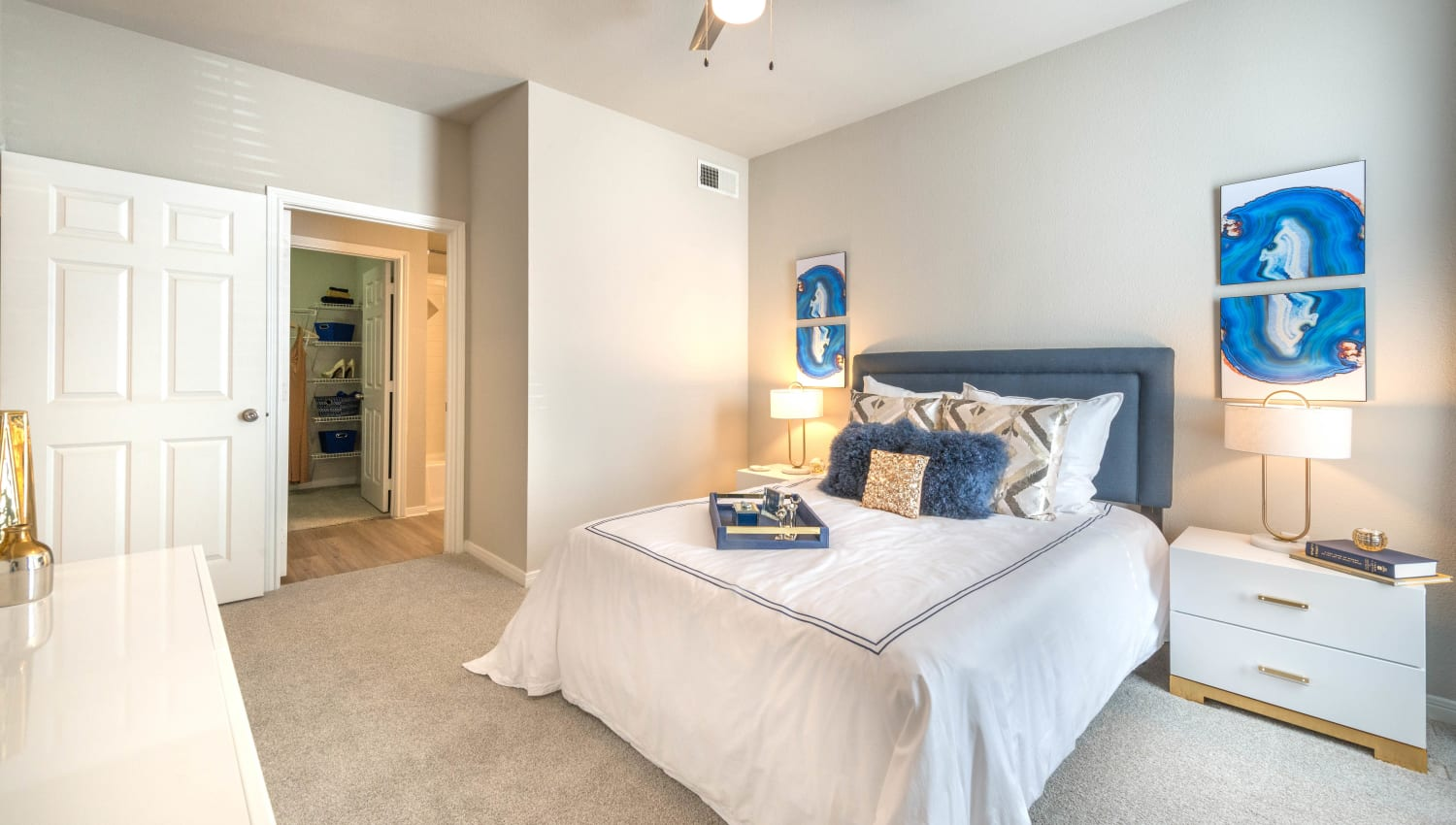 Plush carpeting and ample natural light filling a model home's master bedroom at Olympus Town Center in Keller, Texas