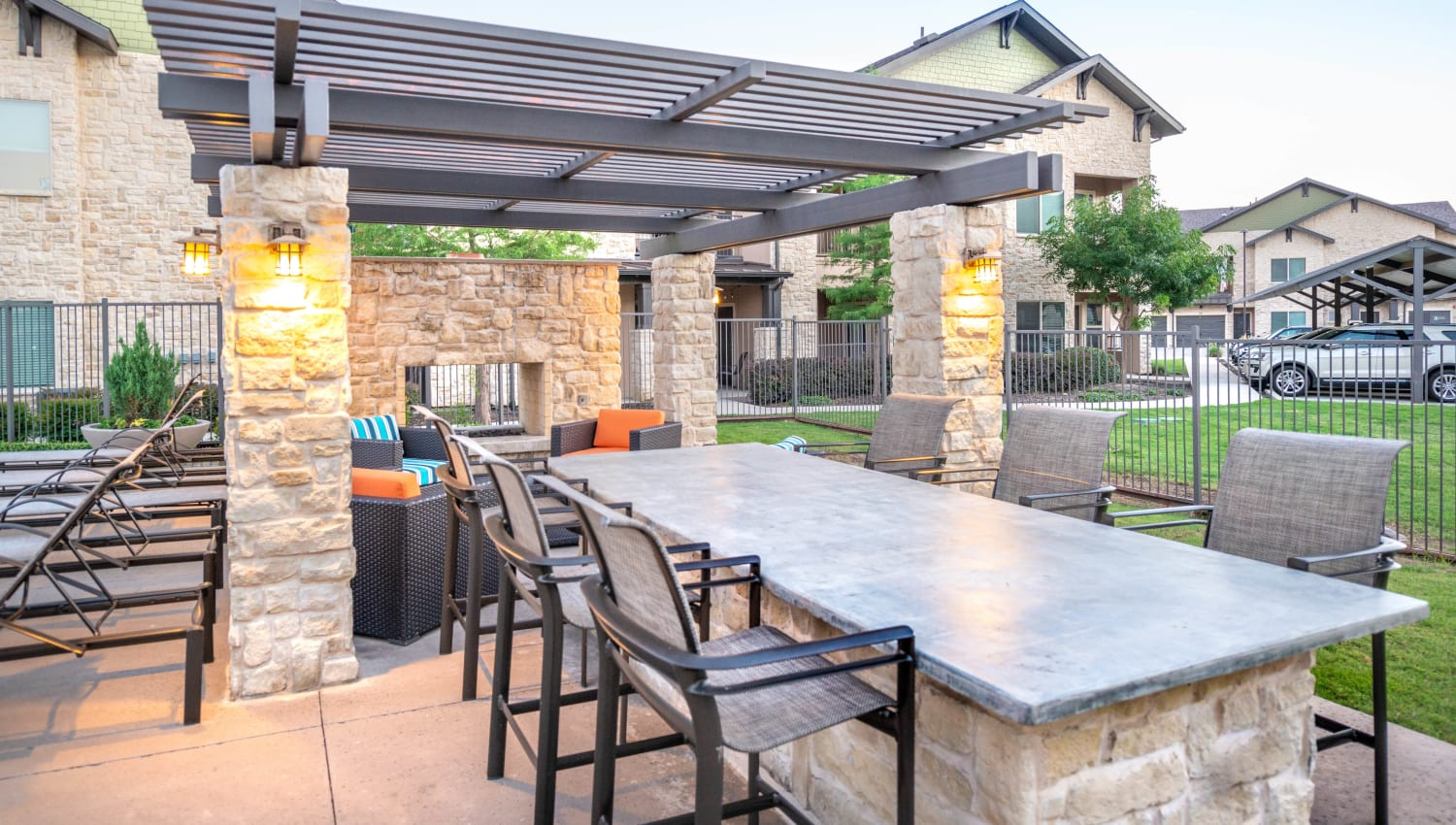 Bar seating at the barbecue area at Olympus Waterford in Keller, Texas