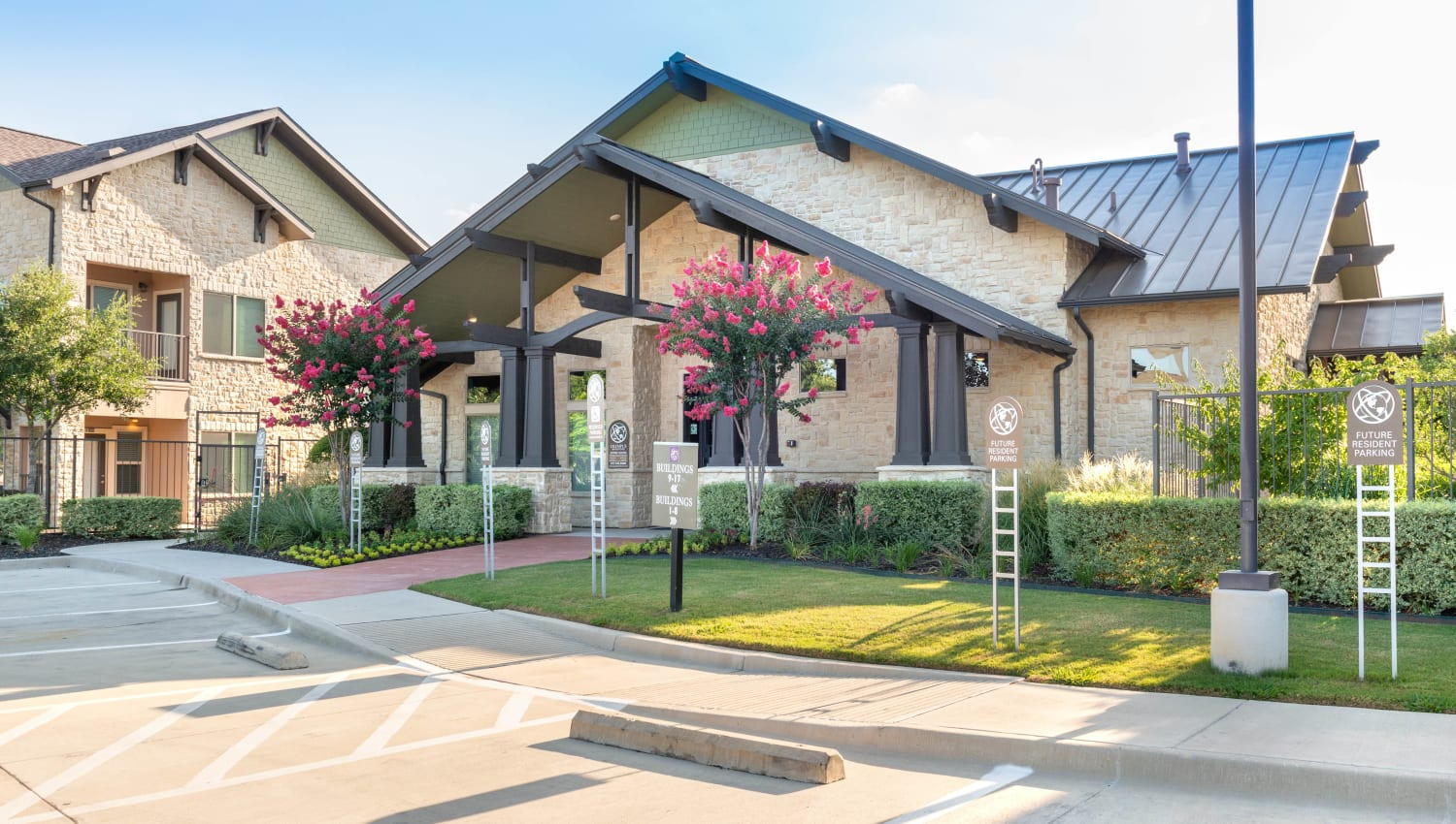 Exterior view of the leasing office on a beautiful morning at Olympus Waterford in Keller, Texas