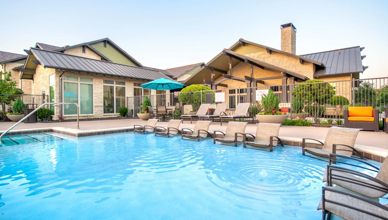 Resort-style swimming pool at Olympus Waterford in Keller, Texas