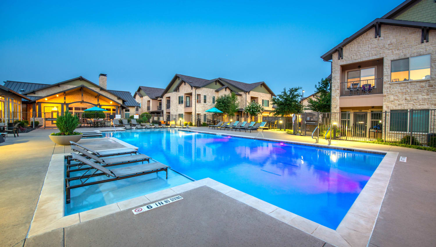 Dusk at the resort-style swimming pool at Olympus Waterford in Keller, Texas
