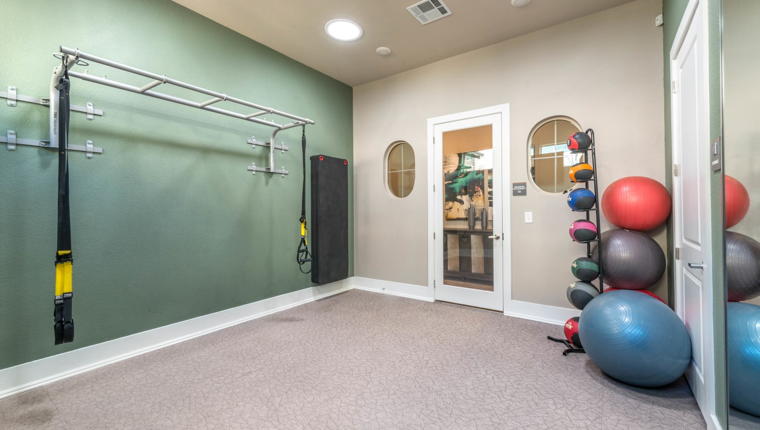 Exercise balls and stretching equipment in the yoga room at Olympus Waterford in Keller, Texas