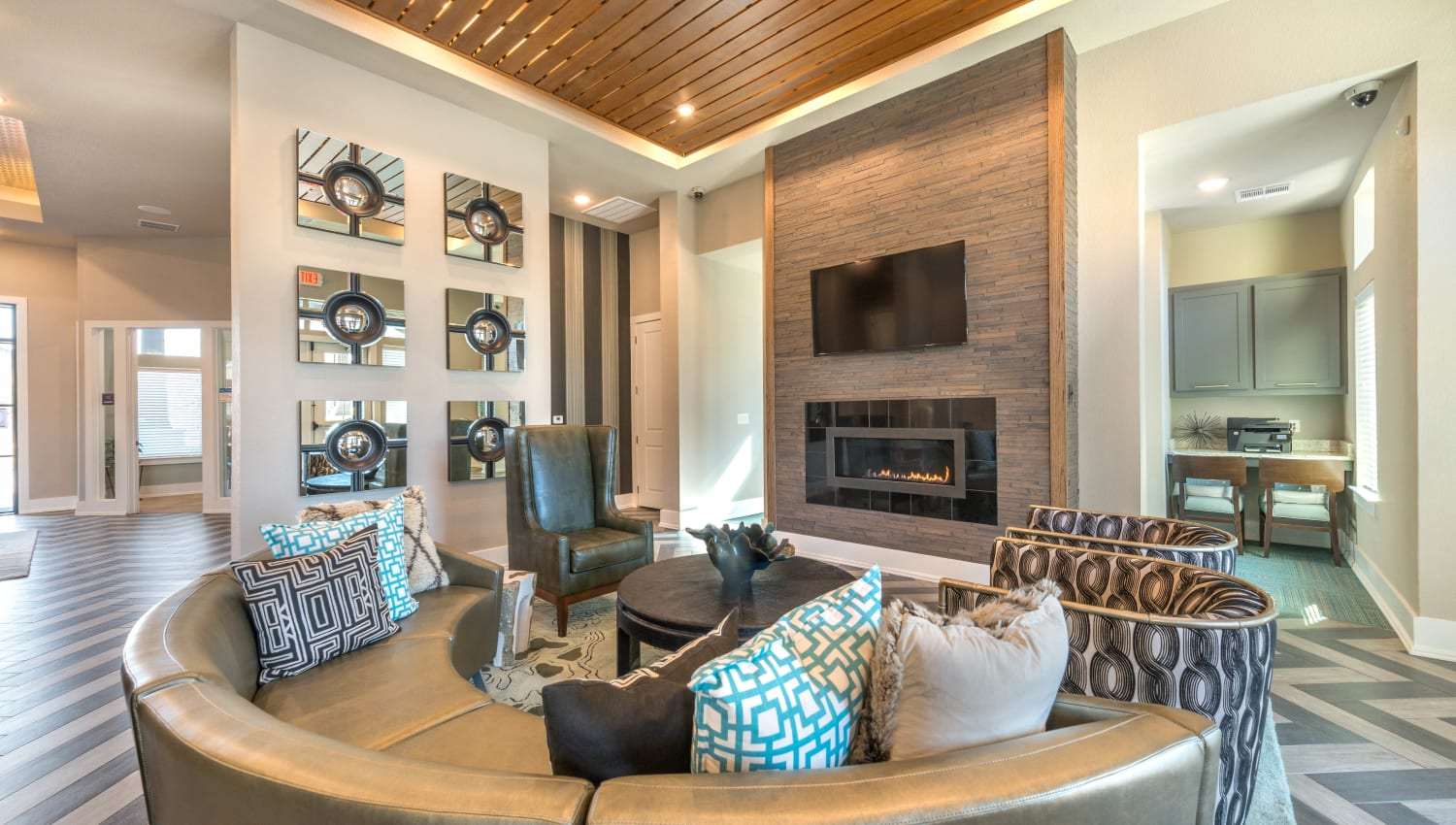Lounge area in front of the fireplace in the clubhouse at Olympus Waterford in Keller, Texas
