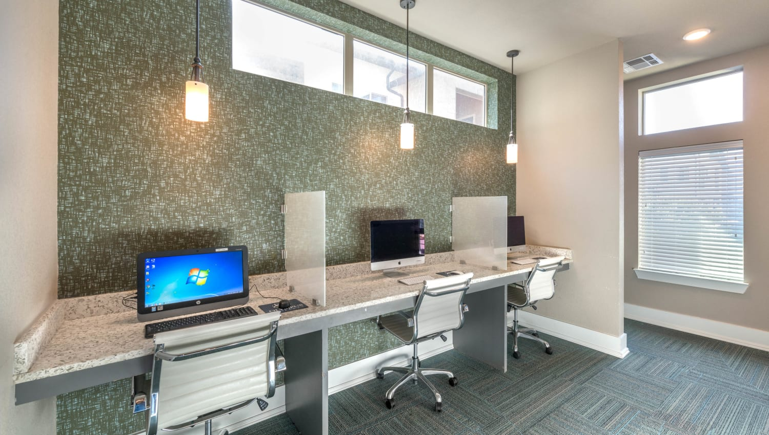 Business center with computers for resident use at Olympus Waterford in Keller, Texas