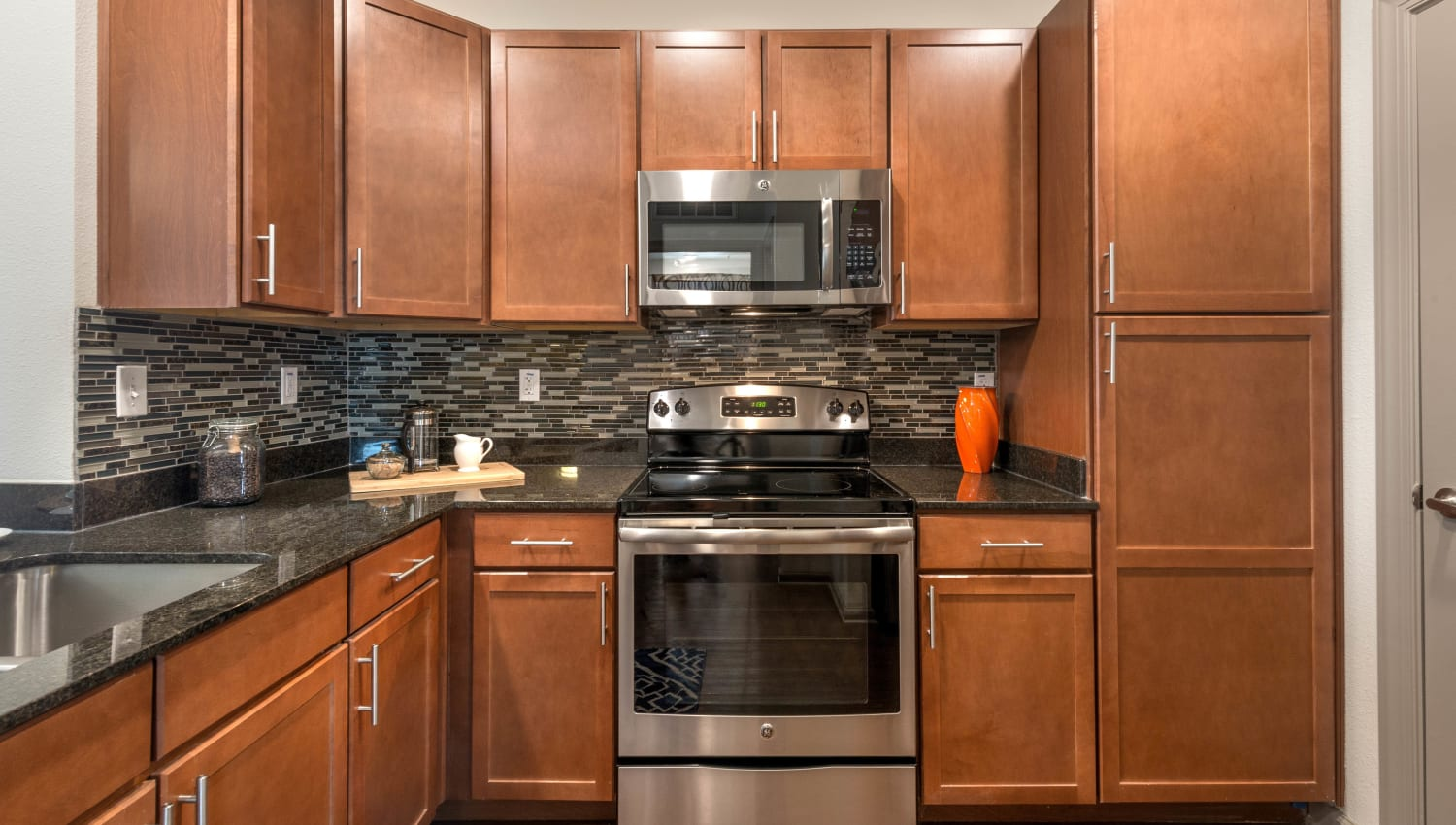 Stainless-steel appliances in a model home's kitchen at Olympus Waterford in Keller, Texas