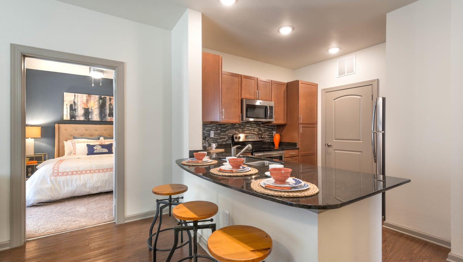 Gourmet kitchen with an island in a model home at Olympus Waterford in Keller, Texas