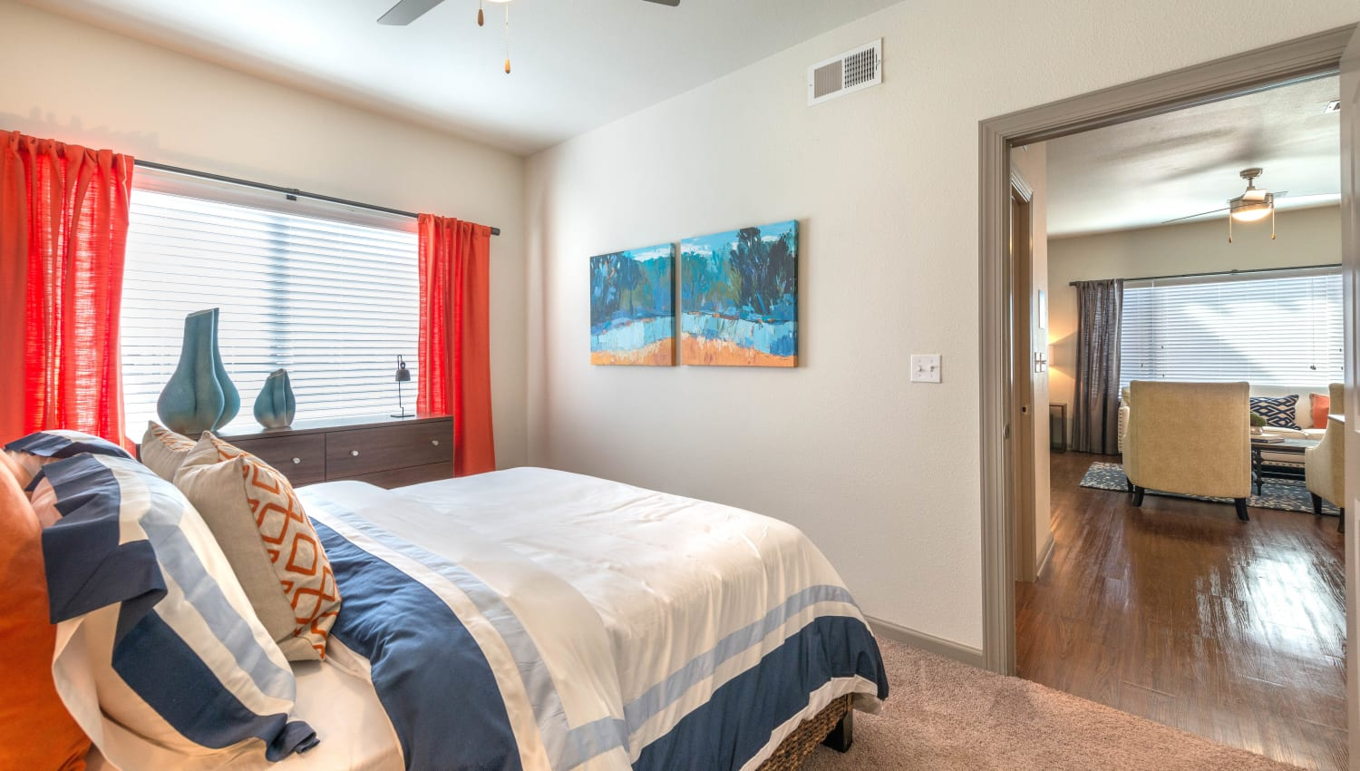 Well-furnished master bedroom in a model apartment at Olympus Waterford in Keller, Texas