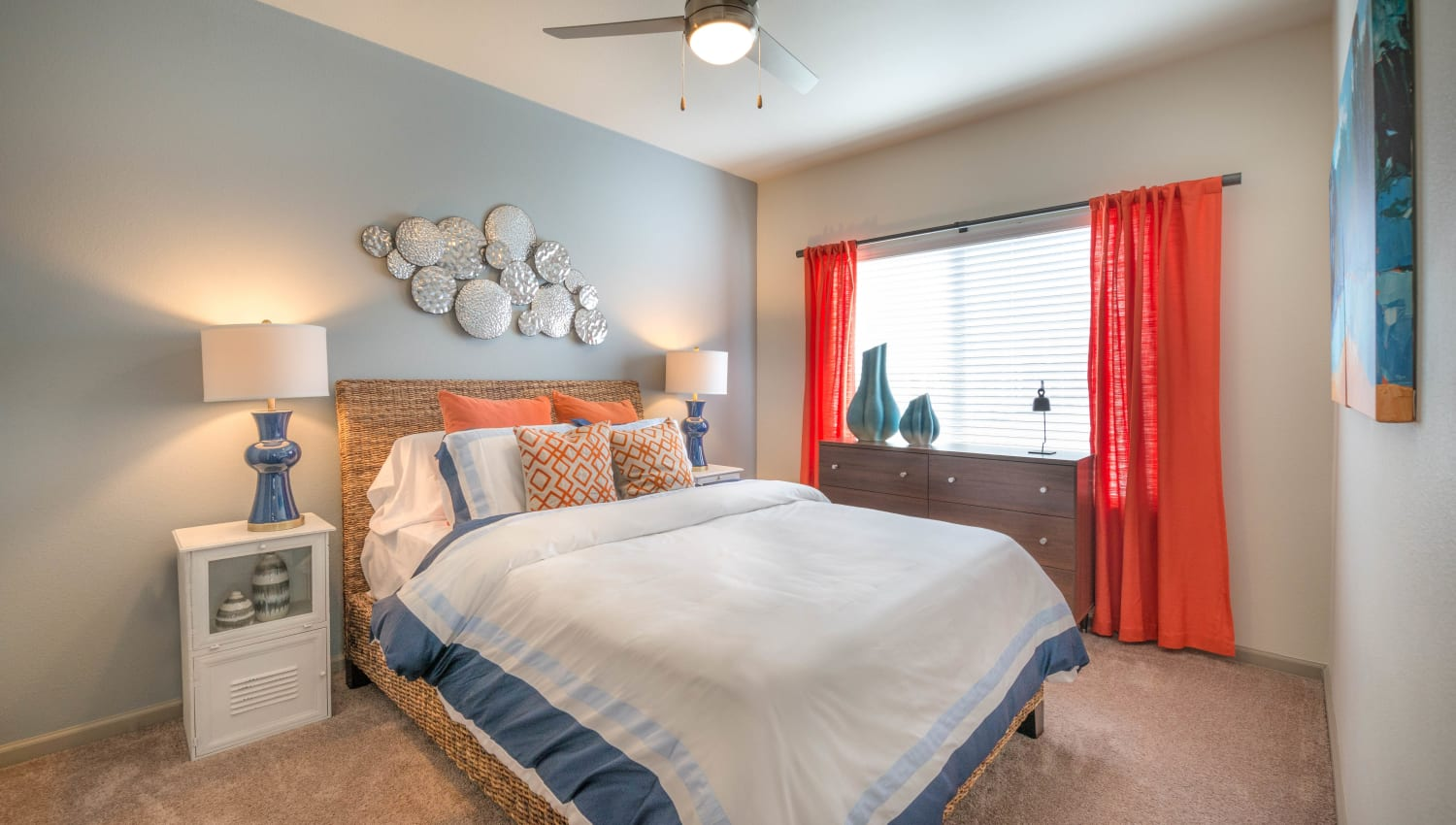 Accent wall and plush carpeting in a model home's master bedroom at Olympus Waterford in Keller, Texas