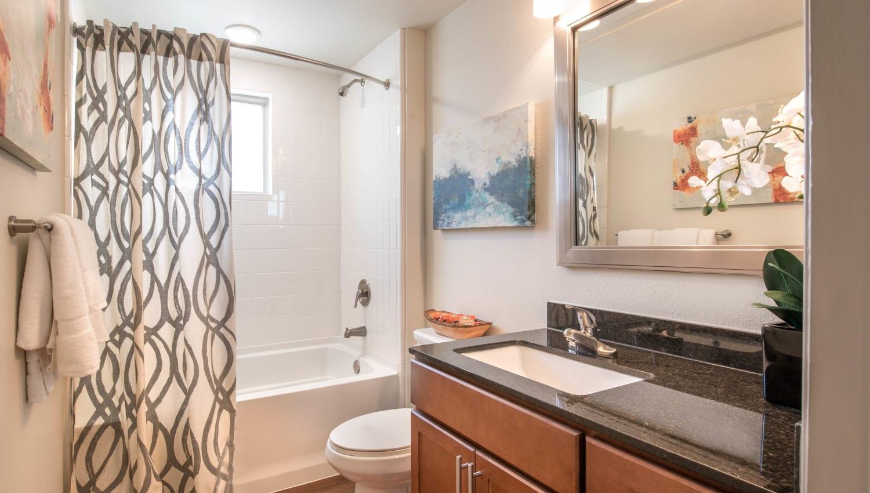 Granite countertop in the guest bathroom of a model apartment at Olympus Waterford in Keller, Texas