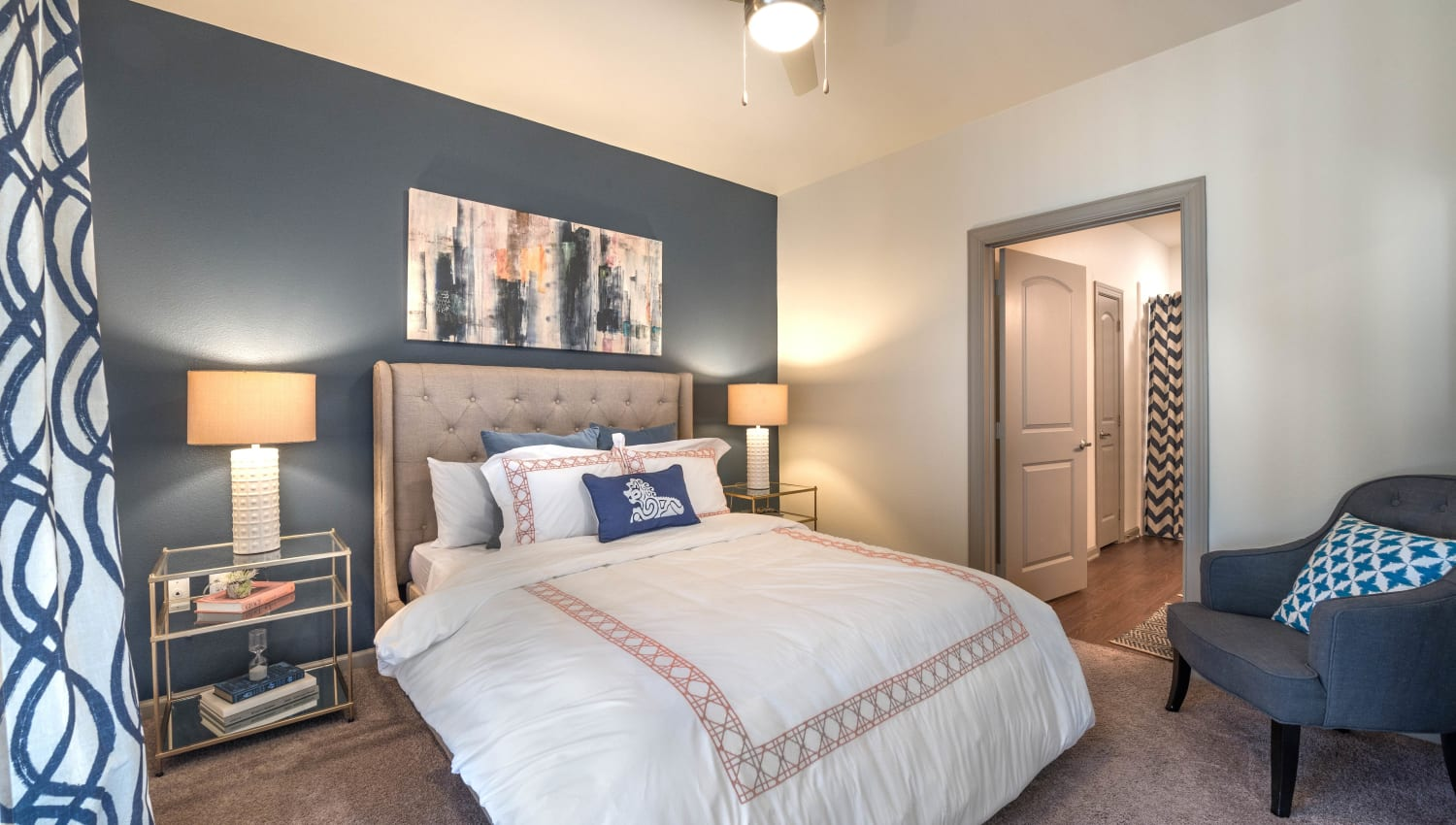 Accent wall in a model home's bedroom at Olympus Waterford in Keller, Texas