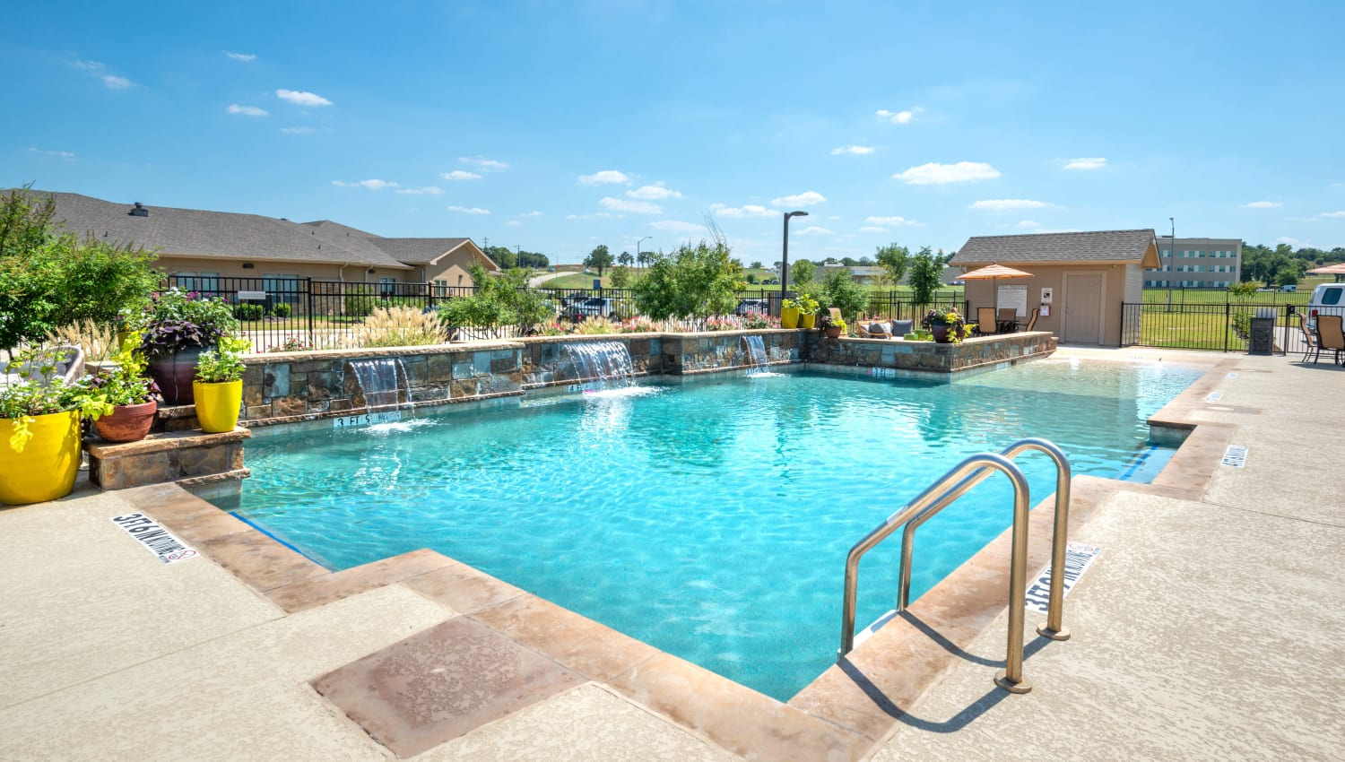 Inviting swimming pool on a gorgeous day at Olympus Willow Park in Willow Park, Texas