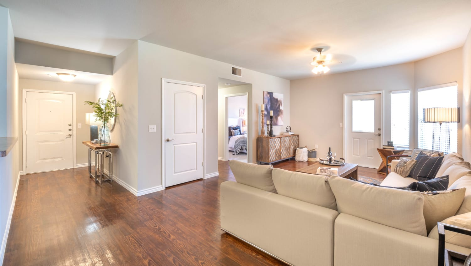 Hardwood floors throughout the living area of a model apartment at Olympus Willow Park in Willow Park, Texas