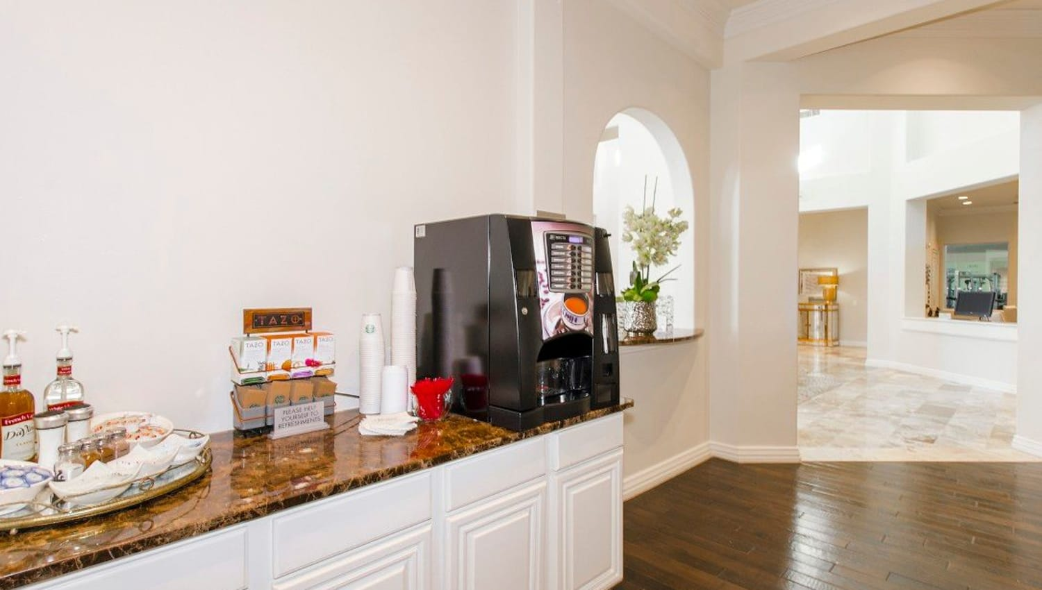 Complimentary coffee station in the clubhouse at Olympus Woodbridge in Sachse, Texas
