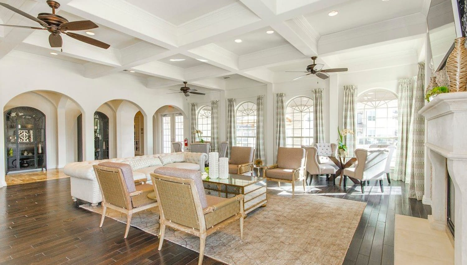 Classic furnishings and beautiful hardwood flooring in the clubhouse at Olympus Woodbridge in Sachse, Texas