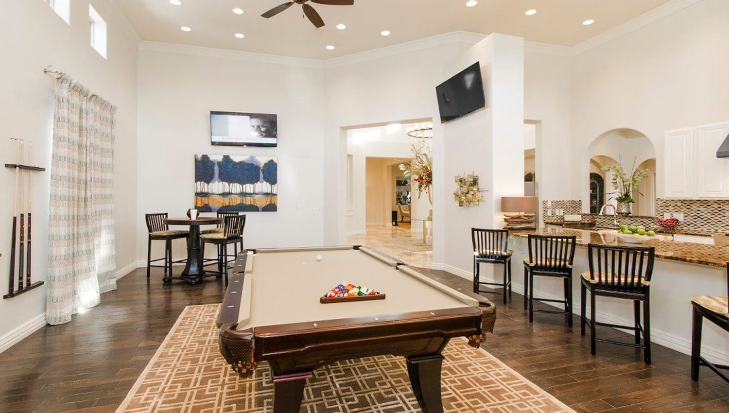Game room with a billiards table and more in the clubhouse at Olympus Woodbridge in Sachse, Texas
