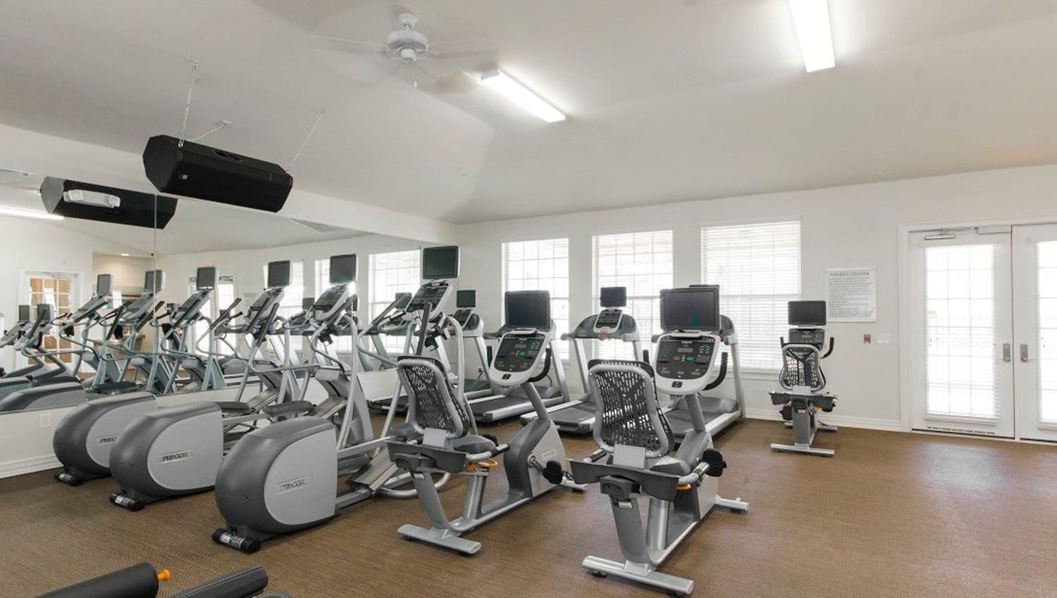 Plenty of cardio machines in the fitness center at Olympus Woodbridge in Sachse, Texas
