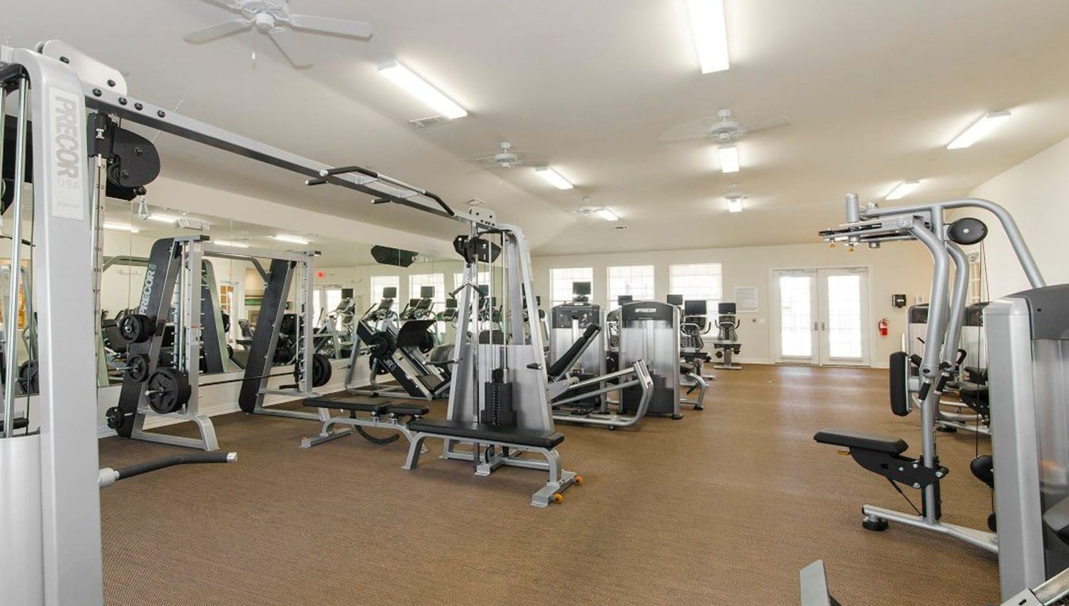 Ample equipment for everyone in the fitness center at Olympus Woodbridge in Sachse, Texas