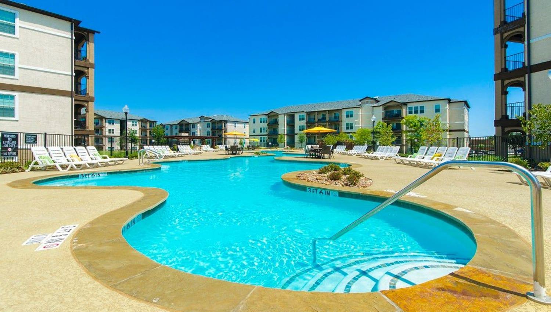 Expansive resort-style swimming pool at Olympus Woodbridge in Sachse, Texas