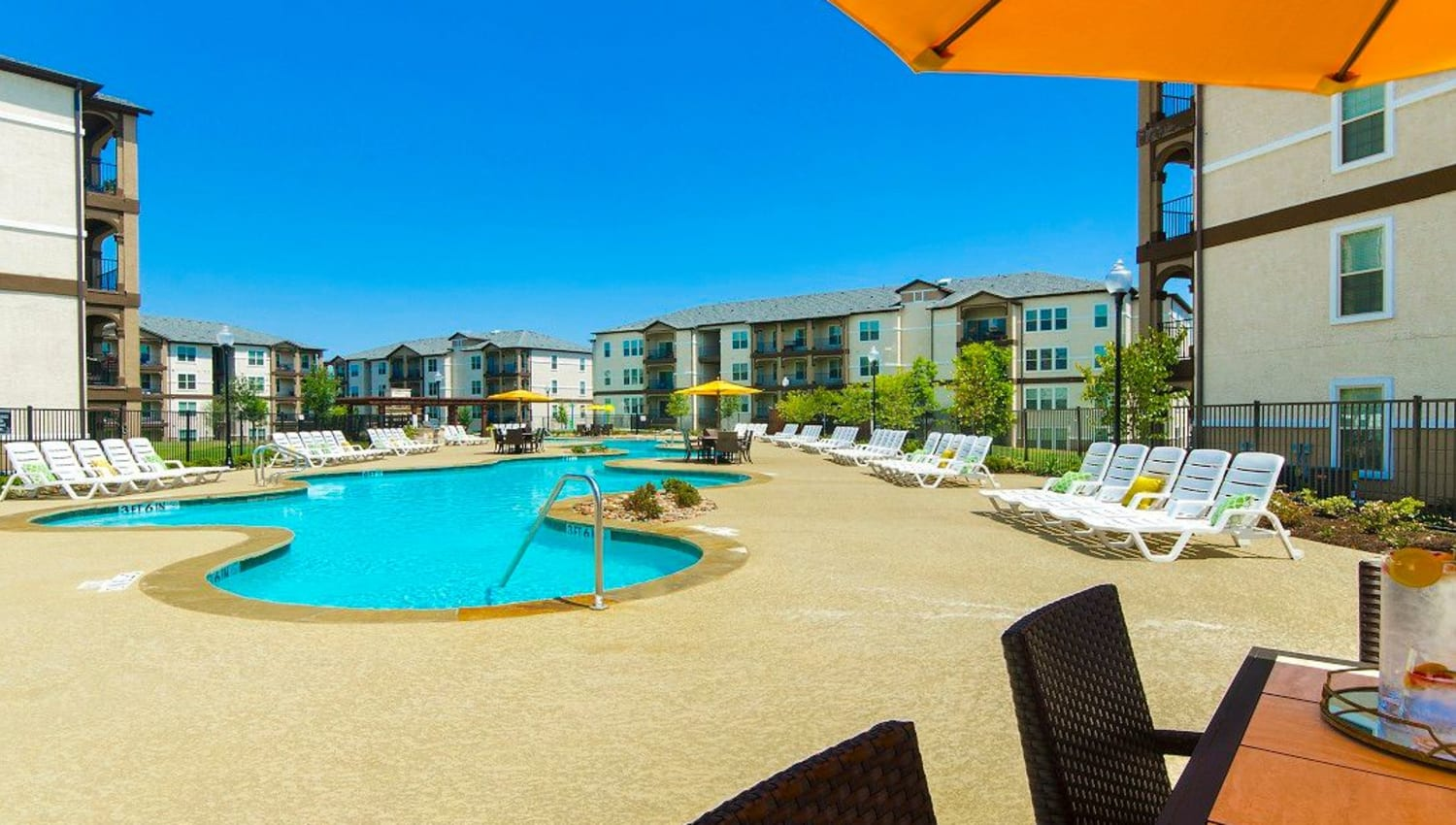 Beautiful day at the swimming pool area at Olympus Woodbridge in Sachse, Texas